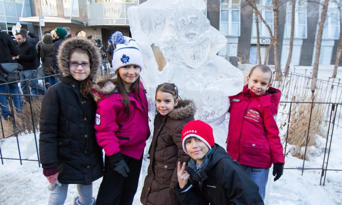 A newly made ice sculpture has already found some young fans. (DQC Photo)