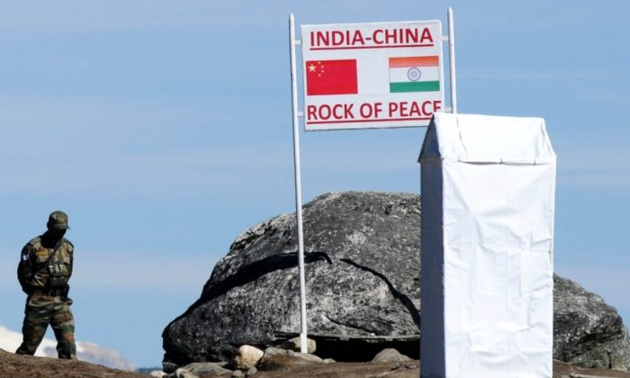 "Indian Army personnel keep vigilance at Bumla pass at the India-China border in Arunachal Pradesh on October 21, 2012. Narendra Modi, India's leading candidate for prime ministerial post, advised China to abandon its ""mindset of expansion"" and declared the disputed territory of Arunachal Pradesh an integral part of India On February 22, 2014. (Biju Boro/AFP/Getty Images)"