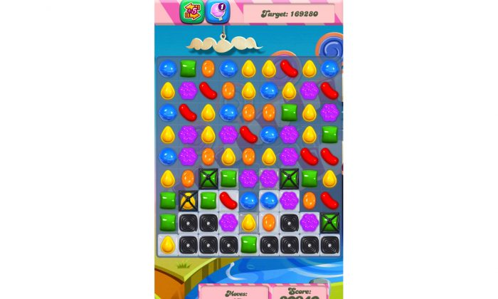 "King Digital Entertainment PLC, maker of the popular ""Candy Crush Saga"" mobile game, is planning to raise up to $500 million from an initial public offering of its common stock. (AP Photo/Candy Crush, File)"