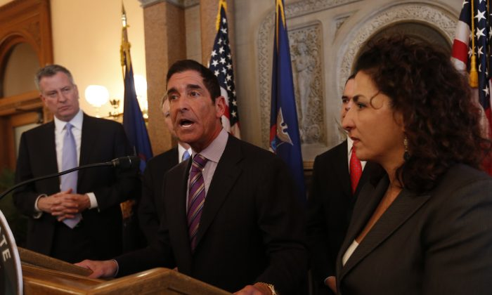 Senate Co-Leader Jeff Klein (C), D-Bronx, holds a press conference along with New York City Mayor Bill de Blasio (L), and Sen. Diane Savino (R), D-Staten Island, in Albany, N.Y. Jan. 8, 2014.  Senators Klein and Savino have been strong supporters of de Blasio's universal pre-K plan for New York City (Mike Groll/AP)
