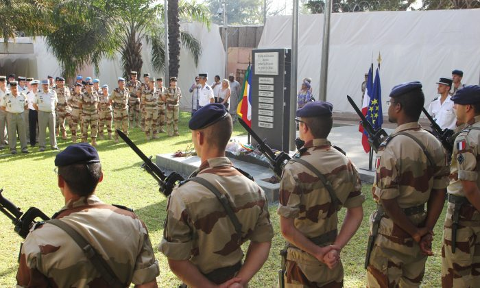 French soldiers stand guard in Bamako, Mali as the French Defense Minister and his Malian counterpart attend an inauguration ceremony for a new monument created in honor of French soldiers killed during the recent military intervention in Mali, Jan. 19, 2014. (Habibou Kouyate/AFP/Getty Images)