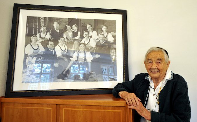 93-year-old Maria von Trapp, daughter of Austrian Baron Georg von Trapp, poses next to an old  family picture after a press conferenceess conference at the Villa Trapp on Friday, July 25, 2008 in Salzburg, Austria. Maria is in the house for the first time since her family fled the Nazi regime to the United States in late 1938. The original von Trapp family home was reopened as a hotel on Friday to give guests the chance to lay their head to rest where the von Trapp family once lived, get married in the house's chapel or have a Sound of Music dinner in the family dining room. (AP Photo/ Kerstin Joensson)
