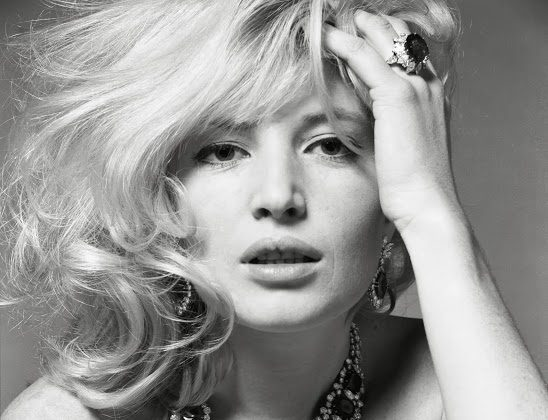 "Monica Vitti wearing the Bulgari ""Seven Wonders"" necklace of platinum, emeralds, and diamonds, 1963. (Courtesy of the de Young Museum and Bulgari)"