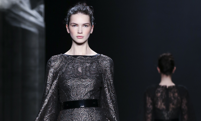 The Monique Lhuillier Fall 2014 collection modeled during Fashion Week in New York, Feb. 8, 2014. (AP Photo/John Minchillo)