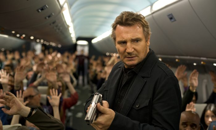 "Liam Neeson stars in ""Non-Stop"" as U.S. Air Marshal Bill Marks. During a transatlantic flight from New York City to London, Marks receives a series of cryptic text messages from an anonymous person who holds the passengers hostage. (Myles Aronowitz/Universal Studios)"