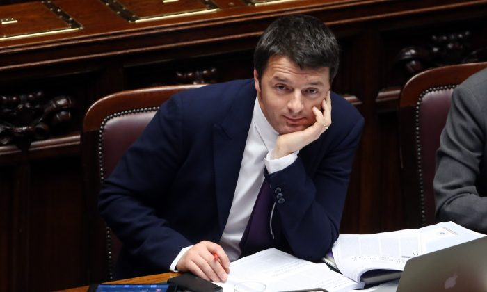 Italy's new Prime Minister Matteo Renzi attends a debate ahead of a confidence vote on his coalition government at the Italian Chamber of Deputies, in Rome on Tuesday. Renzi, 39, is the youngest prime minister in the country's history. (Franco Origlia/Getty Images)