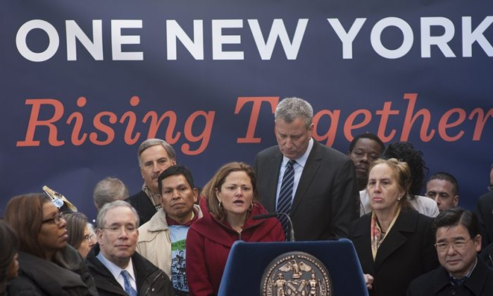 Council Speaker Melissa Mark-Viverito speaks at the announcement of the expansion of paid sick leave in Brooklyn, New York, Jan. 17, 2014. (L-R) Public Advocate Letitia James, Comptroller Scott Stringer, Mayor Bill de Blasio, Manhattan Borough President Gale Brewer, and Council member Peter Koo. (William Alatriste/NYC Council)