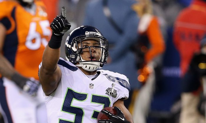 Malcolm Smith #53 of the Seattle Seahawks celebrates running back an interception off Peyton Manning of the Denver Broncos during the second quarter of Super Bowl XLVIII. (Christian Petersen/Getty Images)