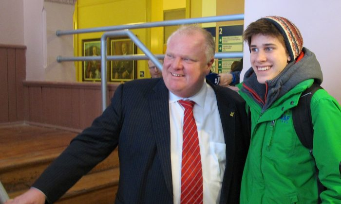 Toronto Mayor Rob Ford poses with one of his many fans who waited to have a picture taken with him during a break in the Big City Mayors' Caucus held in Ottawa on Feb. 26, 2014. (Pam McLennan/Epoch Times)