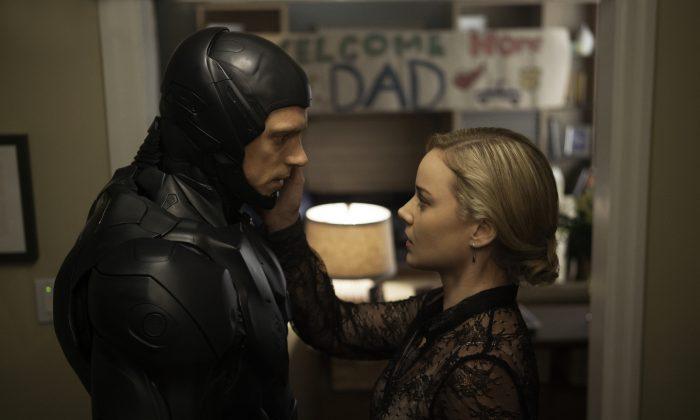 "Joel Kinnaman and Abby Cornish in ""Robocop."" (AP photo/Columbia Pictures)"