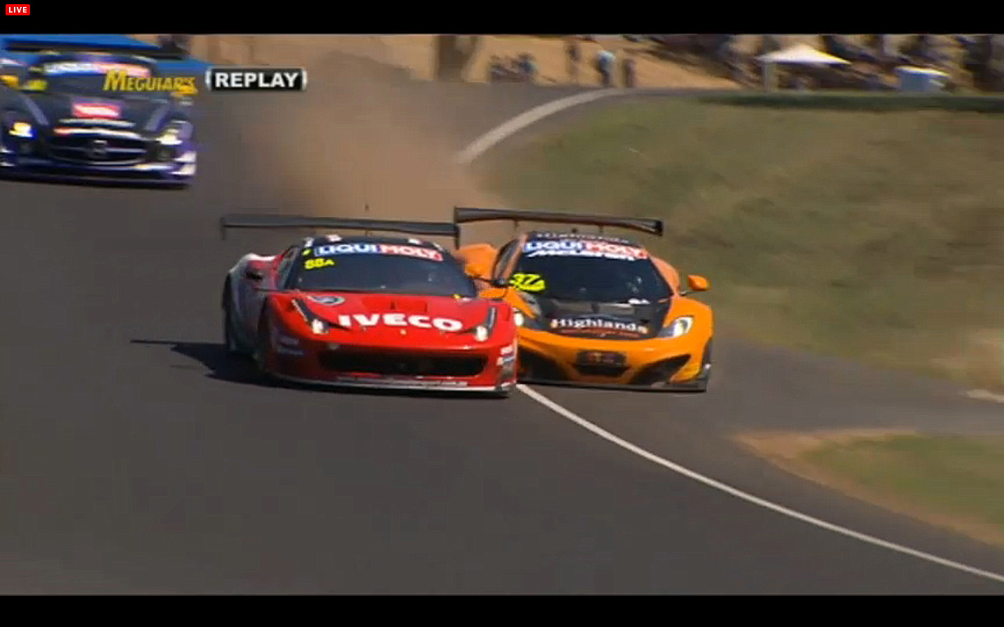 Shane Van Gisbergen in the #37 McLaren almost wrecks trying to pass Mika Salo in the #88 Maranello Ferrari. (bathurst12hour.com.au)