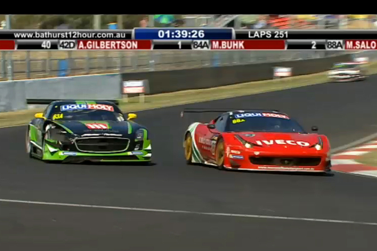 Mika Salo in the #88 Ferrari passes Greg Crick in the damaged #63 Mercedes to take second place with 1:40 left in the race. (bathurst12hour.com.au)