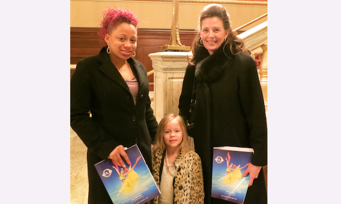 Barbara Cunningham, with her granddaughter and her mother, enjoys Shen Yun Performing Arts at Cleveland's State Theatre, on Feb. 2. (Stacey Tang/Epoch Times)
