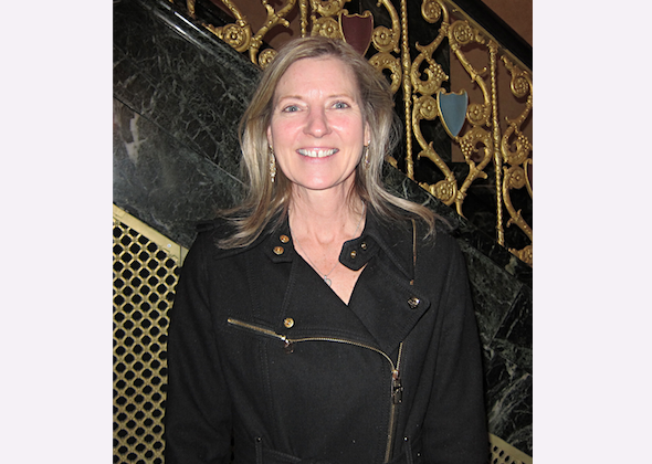 Kelly Walters enjoys Shen Yun Performing Arts at the Detroit Opera House, on Feb. 6. (Valerie Avore/Epoch Times)