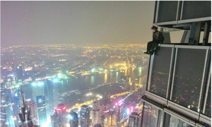 Screenshot showing one of two young Chinese men, who scaled the Shanghai Tower, China's tallest building. (Screenshot/china.org.cn)