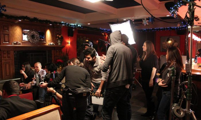 LNC's creative director David Levy (C) works on the set for a short film production.  (Courtesy of LNC Productions)