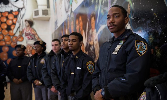 New York City Police Department Explorers attend a press conference held by Mayor Bill De Blasio announcing that the city will not appeal a judge's ruling that the police tactic 'Stop-and-Frisk' is unconstitutional, on Jan. 30, 2014. (Andrew Burton/Getty Images)