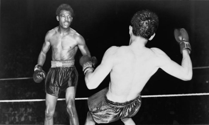 Sugar Ray Robinson (L) and Jimmy Doyle (R). (Wikimedia Commons)