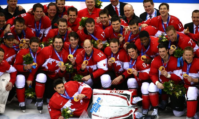 The Canadian Men's Ice Hockey team celebrates its gold medal at the Sochi 2014 Winter Olympics in Sochi, Russia on Feb. 23, 2014. (Streeter Lecka/Getty Images)