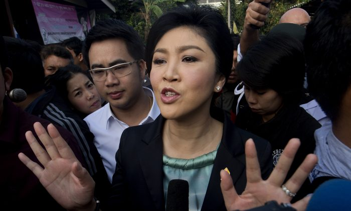 Thai Prime Minister Yingluck Shinawatra answers questions from the press after voting at a polling station in Bangkok on Feb 2. (Pornchai Kittiwongsakul/AFP/Getty Images)