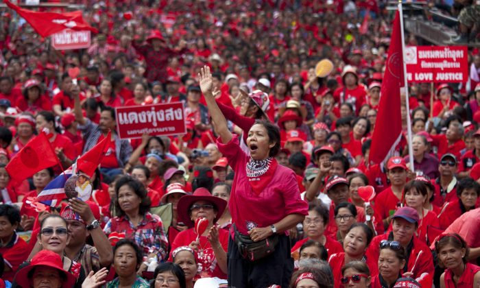 Red shirts cheer during a rally as tens of thousands gathered May 19, 2012, to commemorate the second anniversary of the violent government crackdown in Bangkok, Thailand.(Paula Bronstein/Getty Images)
