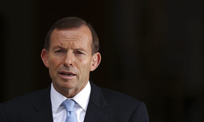 Prime Minister Tony Abbott speaks at a press conference in Canberra, Australia, on Nov. 12, 2013. Activists believe Australia has done too little to pressure China on its human rights abuses. (Stefan Postles/Getty Images)