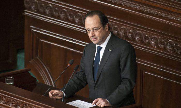 French President Francois Hollande delivers his speech at the Constituent Assembly in Tunis, Friday, Feb. 7, 2014. (AP Photo/Aimen Zine)