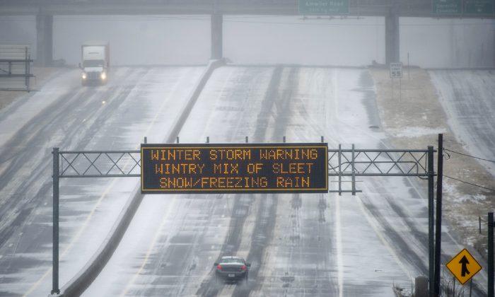 Georgia DOT sign warns drivers of an ice storm on Hwy. 141 on Feb. 12, 2014, near Atlanta, in Norcross, Ga.  (AP Photo/John Amis)