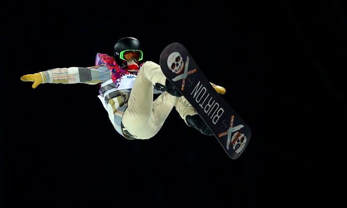 Shaun White of the United States practices before the Snowboard Men's Halfpipe Finals on day four of the Sochi 2014 Winter Olympics at Rosa Khutor Extreme Park on February 11, 2014 in Sochi, Russia. (Cameron Spencer/Getty Images)