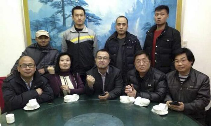In this Feb. 1, 2014 photo released by Citizen Watchers Group, nine members of the spontaneous formed group convene at a restaurant to demand a thorough investigation into the death of Xue Fushun, a fellow activist's father, in Qufu, in eastern China's Shandong province. The Qufu gathering was triggered by the sudden death of Xue Fushun, the father of Xue Mingkai, a dissident who has been jailed twice for his opposition to China's one-party rule and who is now feared detained by authorities. (AP Photo/Citizen Watchers Group)