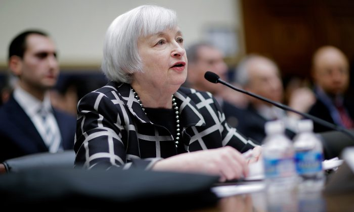 New U.S. Federal Reserve Board chairwoman Janet Yellen gives her first testimony before the House Financial Services Committee in Washington, D.C., on Feb. 11, 2014. (T.J. Kirkpatrick/Getty Images)