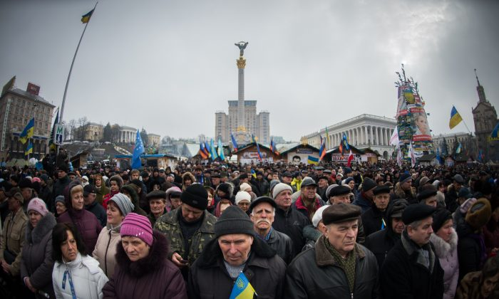 Demonstrators take part in a mass rally of the opposition on Independence Square in Kiev on Feb. 9, 2014. An estimated 70,000 pro-Western Ukrainians thronged the heart of Kiev vowing never to give up their drive to oust President Viktor Yanukovych for his alliance with old master Russia. (Martin Bureau/AFP/Getty Images)