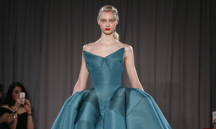 The Zac Posen Fall 2014 collection modeled during Fashion Week in New York, Monday, Feb. 10, 2014. (AP Photo/Jason DeCrow)