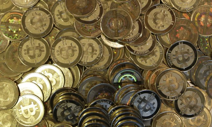 File photo shows bitcoin tokens in Sandy, Utah.  The website of major bitcoin exchange Mt. Gox is offline Tuesday, Feb. 25, 2014, amid reports it suffered a debilitating theft, a new setback for efforts to gain legitimacy for the virtual currency.  (AP Photo/Rick Bowmer, File)
