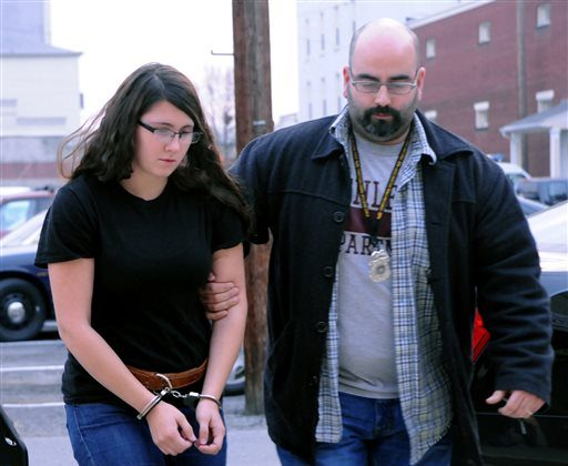 In this Tuesday, Dec. 3, 2013 file photo, Miranda K. Barbour is led into District Judge Ben Apfelbaum's office in Sunbury, Pa., by Sunbury policeman Travis Bremigen. In an interview with The Daily Item newspaper published Feb. 15, 2014, Barbour, charged along with her newlywed husband Elytte Barbour in the murder of a man they met through Craigslist, admitted to the slaying and said she has killed more than 20 others across the country, claims police said they are investigating.  (AP Photo/The News-Item, Mike Staugaitis, File)