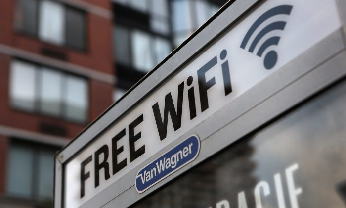 A free Wi-Fi hotspot atop a public phone booth in Manhattan, New York, on July 11, 2012 (John Moore/Getty Images)