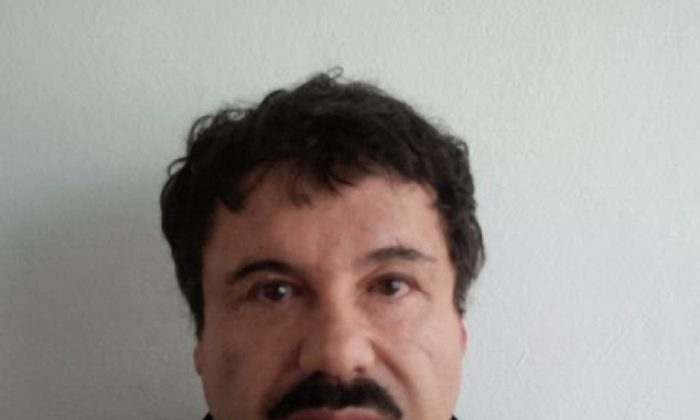 """In this image released by Mexico's Attorney General's Office, Saturday, Feb. 22, 2014, Joaquin """"El Chapo"""" Guzman is photographed against a wall after his arrest in the Pacific resort city of Mazatlan, Mexico. (AP Photo/PGR)"""