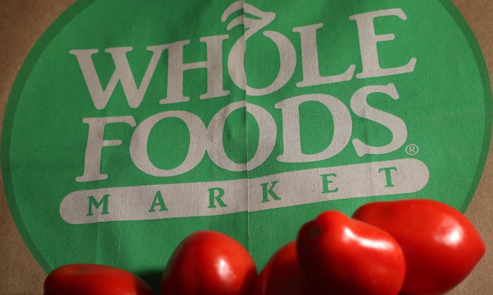FILE - This July 29, 2013 file photo shows produce on a Whole Foods paper bag in Andover, Mass. Large food companies are trying to head off state-by-state efforts to enact mandatory labeling of genetically modified ingredients by proposing new voluntary labels nationwide. The food industry and farm groups are pushing Congress to pass legislation that would require the Food and Drug Administration to create guidelines for the new labels, which food manufacturers could use. (AP Photo/Elise Amendola, File)