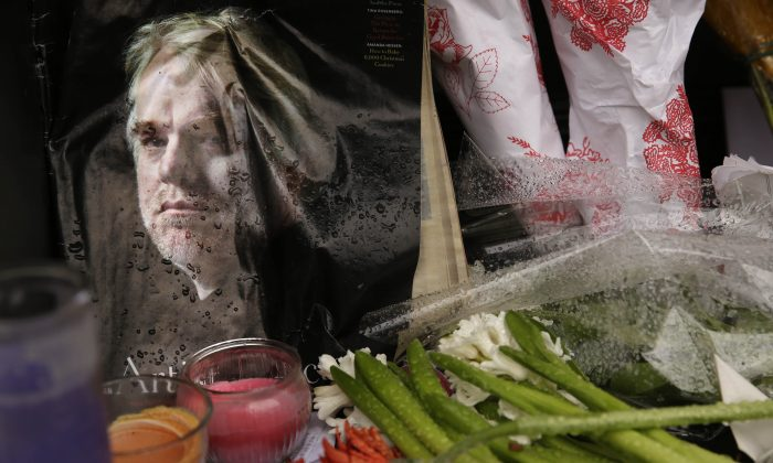 A makeshift memorial is seen, Feb. 3, 2014, outside the building where the body of actor Philip Seymour Hoffman was found in New York. (AP Photo/Seth Wenig)