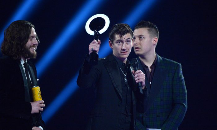 Arctic Monkeys band member Alex Turner accepts the Best British Group award onstage at the BRIT Awards 2014 at the O2 Arena in London on Wednesday, Feb. 19, 2014. (Jon Furniss/Invision/AP)