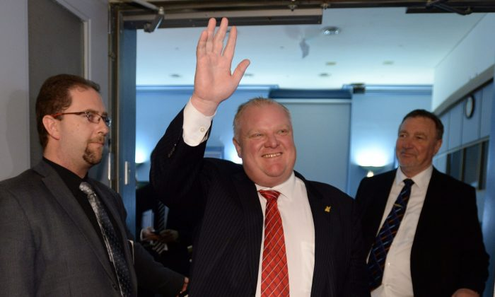 "Toronto Mayor Rob Ford waves as he leaves the Big City Mayor's Meeting at Ottawa City Hall in Ottawa on Feb. 26, 2014. Toronto Police Chief Bill Blair said he is ""deeply offended"" by remarks Ford made about him in a videotaped profane rant. (The Canadian Press/Sean Kilpatrick)"