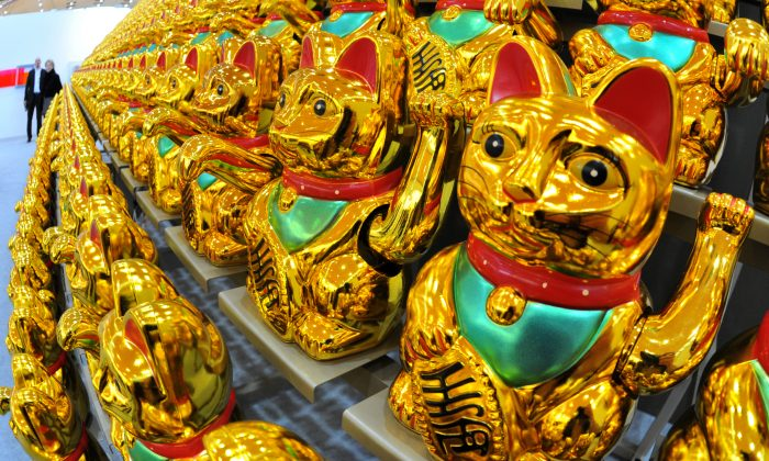 """The artwork """"The Global Pursuit of Happiness, or: The Army of Luck"""" by artist Boris Petrovsky is displayed at an art fair in Karlsruhe, western Germany, on March 7, 2012. (Uli Deck/AFP/Getty Images)"""