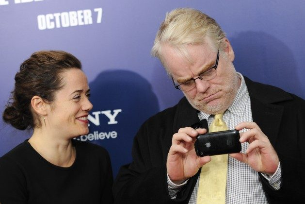 "Actor Philip Seymour Hoffman and girlfriend Mimi O'Donnell attend the premiere of ""Ides of March"" at the Ziegfeld Theatre on Wednesday, Oct. 5, 2011 in New York. (AP Photo/Evan Agostini)"