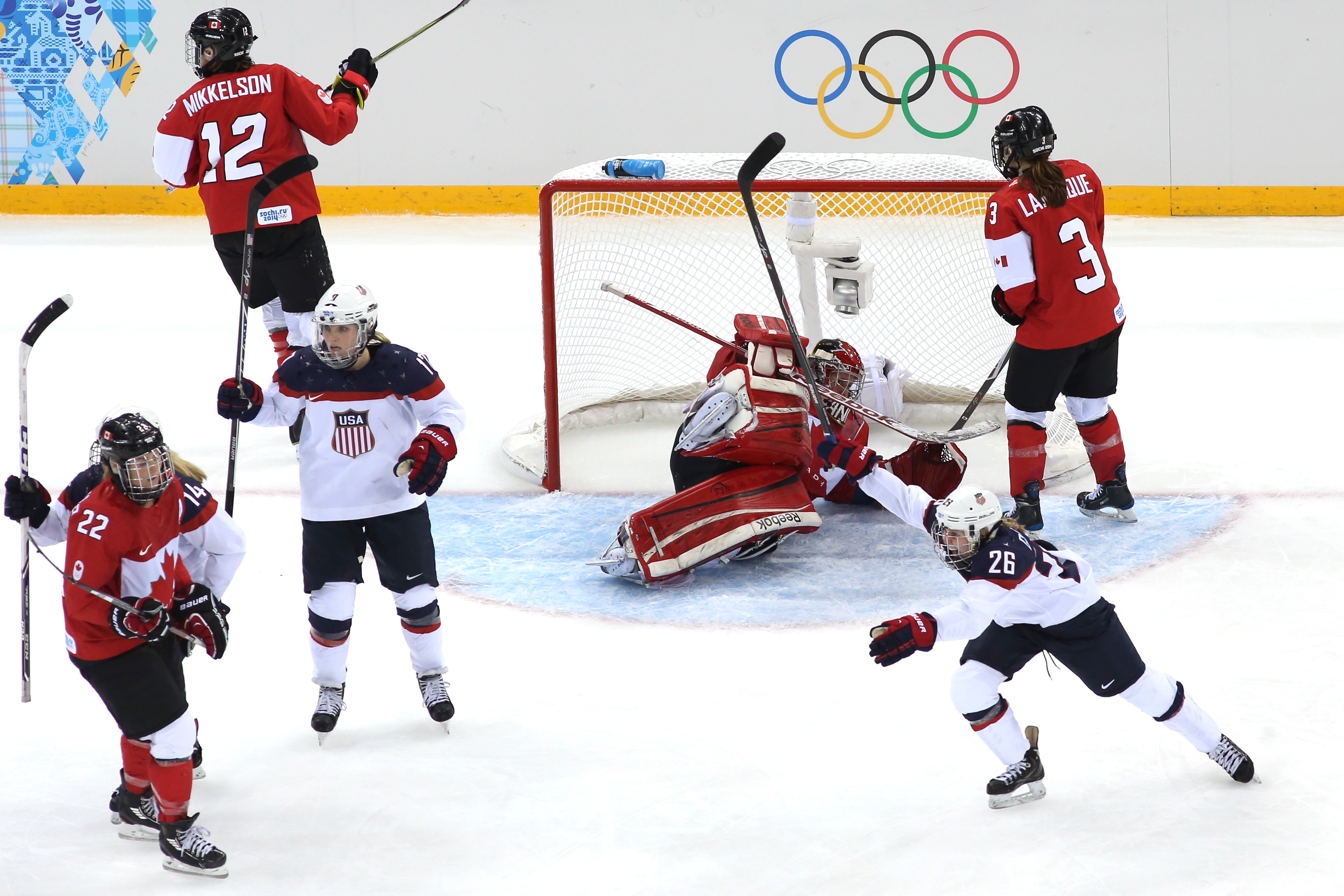 Kendall Coyne #26 of the United States celebrates as #32 Charline Labonte of Canada allows a goal by Anne Schleper #15 in the third period during the U.S.-Canada Women's Ice Hockey Preliminary Round Group A game. (Bruce Bennett/Getty Images)