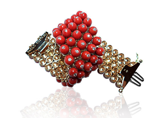 Paolo Costagli 18-karat rose gold bracelet set with coral and 4.13 carats of diamonds, $60,000, paolocostagli.com.