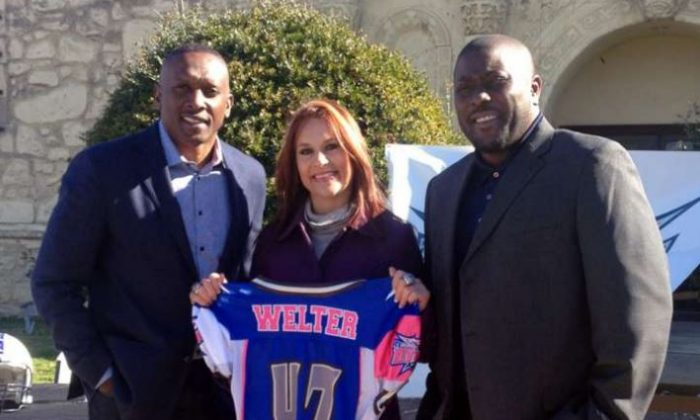 Texas Revolution general manager and 1987 Heisman Trophy winner Tim Brown (left) signed Jennifer Welter in January to try out at running back. (Texas Revolution)