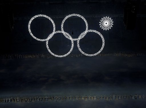One of the Olympic rings fails to open during the opening ceremony of the 2014 Winter Olympics in Sochi, Russia, Friday, Feb. 7, 2014. (AP Photo/David J. Phillip)