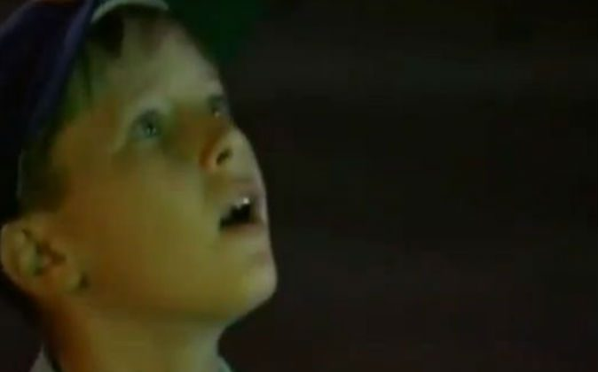 A boy looks up into the sky in a dramatic HD video. (Screenshot/Frank Gregorio/YouTube)