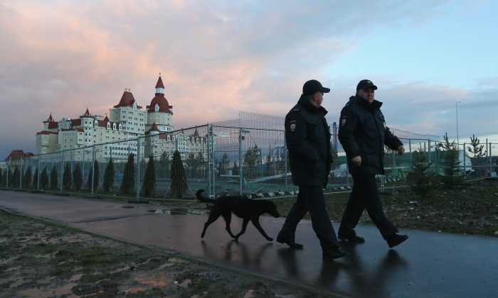 Security guards patrol the perimeter of the Olympic Park prior to the 2014 Winter Olympics at the Olympic Park in Sochi, Russia, on Feb. 1, 2014. (Streeter Lecka/Getty Images)