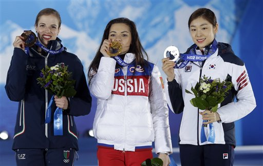 Women's free skate figure skating medalists, from left, Italy's Carolina Kostner, bronze, Russia's Adelina Sotnikova, gold, and South Korea's Yuna Kim, silver, pose with their medals at the 2014 Winter Olympics in Sochi, Russia, Friday, Feb. 21, 2014. (AP Photo/Darron Cummings)